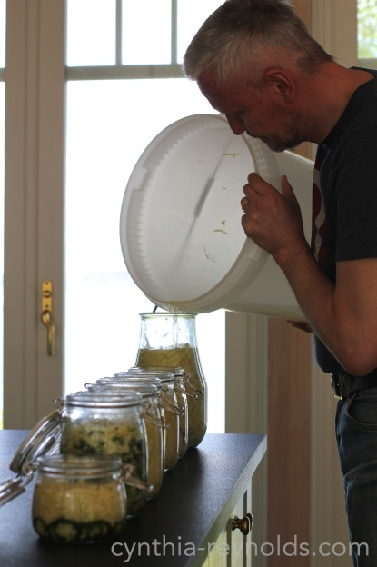 once packed, the remaining brine is topped up in each jar